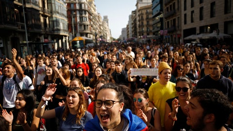 <p>               Protestors crowd a street in Barcelona, Spain, Monday, Oct. 14, 2019. Spain's Supreme Court on Monday convicted 12 former Catalan politicians and activists for their roles in a secession bid in 2017, a ruling that immediately inflamed independence supporters in the wealthy northeastern region. (AP Photo/Emilio Morenatti)             </p>