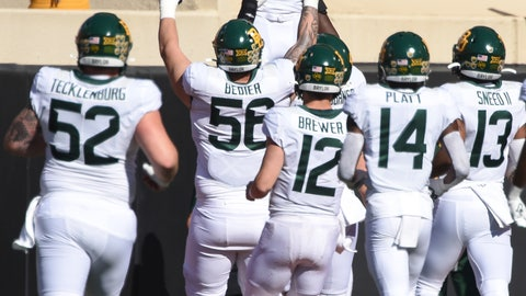 <p>               Baylor running back John Lovett (7) is lifted by teammates as he celebrates the first touchdown in the first half of an NCAA college football game against Oklahoma State in Stillwater, Okla., Saturday, Oct. 19, 2019. (AP Photo/Brody Schmidt)             </p>