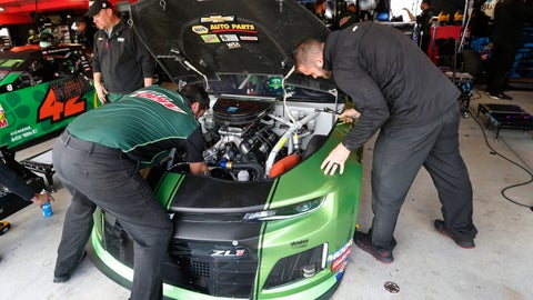 <p>               The crew for Chase Elliott work on his car in the garage at Martinsville Speedway In Martinsville, Va., Saturday, Oct. 26, 2019. Elliott had an engine failure less than five minutes into the opening practice for the third round of NASCAR's playoffs. (AP Photo/Steve Helber)             </p>