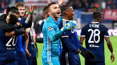 <p>               Lyon goalkeeper Anthony Lopes celebrates with team mates after winning the Champions League group G first round soccer match between RB Leipzig and Olympique Lyon, in Leipzig, Germany, Wednesday, Oct. 2, 2019. (AP Photo/Jens Meyer)             </p>