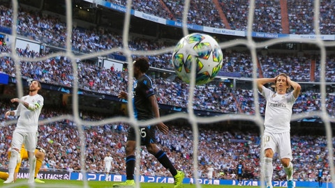 <p>               Real Madrid's Luka Modric, right, and Sergio Ramos, left, react after Brugge's Emmanuel Dennis scored his side's second goal during the Champions League group A soccer match between Real Madrid and Club Brugge, at the Santiago Bernabeu stadium in Madrid, Tuesday, Oct.1, 2019. (AP Photo/Manu Fernandez)             </p>