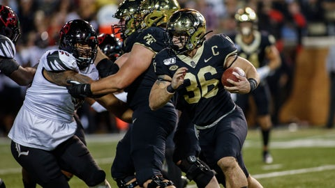 <p>               Wake Forest running back Cade Carney, right, carries the football against Louisville during the first half of an NCAA college football game in Winston-Salem, N.C., Saturday, Oct. 12, 2019. (AP Photo/Nell Redmond)             </p>
