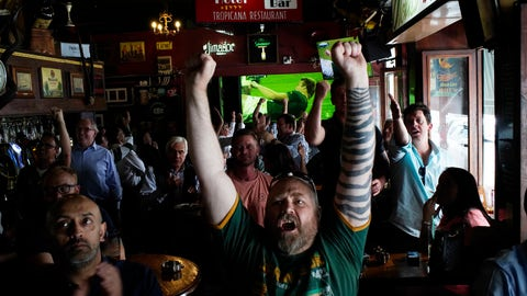 <p>               South African fans react to their team scoring as they watch in Johannesburg, South Africa Friday Oct. 4, 2019 in a local pub the Rugby World Cup Pool B game between South Africa and Italy being played in Japan South Africa defeated Italy 49-3. (AP Photo/Jerome Delay)             </p>