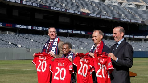 <p>               Chicago Fire owner Joe Mansueto, second from right, poses with Chicago Parks Superintendent Michael P. Kelly, left, Mayor Lori Lightfoot, and Major League Soccer Commissioner Don Garber, right, after Mansueto announced that the MLS soccer team will play their 2020 season in Soldier Field Tuesday, Oct. 8, 2019, in Chicago. (AP Photo/Charles Rex Arbogast)             </p>