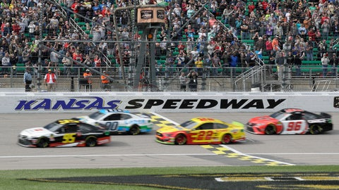<p>               Matt DiBenedetto (95), Landon Cassill (00), Joey Logano (22) and Parker Kligerman (96) take the green flag during a NASCAR Cup Series auto race at Kansas Speedway in Kansas City, Kan., Sunday, Oct. 20, 2019. (AP Photo/Orlin Wagner)             </p>