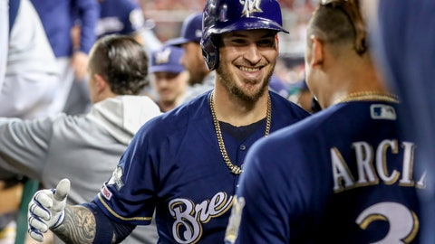<p>               Milwaukee Brewers' Yasmani Grandal, center, celebrates with teammate Orlando Arcia (3) after hitting a two-run home run during the first inning of a National League wild card baseball game against the Washington Nationals at Nationals Park, Tuesday, Oct. 1, 2019, in Washington. (AP Photo/Andrew Harnik)             </p>