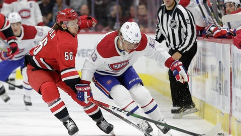 <p>               Carolina Hurricanes left wing Erik Haula (56), of Finland, reaches across Montreal Canadiens center Max Domi (13) during the first period of an NHL hockey game in Raleigh, N.C., Thursday, Oct. 3, 2019. (AP Photo/Gerry Broome)             </p>