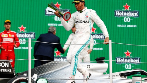 <p>               Mercedes driver Lewis Hamilton, of Britain, celebrates on the podium after winning the Formula One Mexico Grand Prix auto race at the Hermanos Rodriguez racetrack in Mexico City, Saturday, Oct. 26, 2019. (AP Photo/Eduardo Verdugo)             </p>