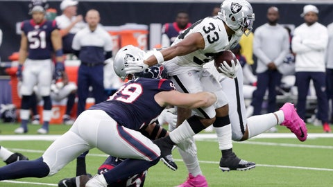 <p>               Oakland Raiders running back DeAndre Washington (33) is hit by Houston Texans defensive end J.J. Watt (99) on a run during the first half of an NFL football game Sunday, Oct. 27, 2019, in Houston. (AP Photo/Michael Wyke)             </p>