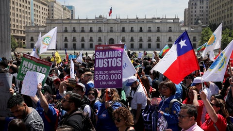 <p>               Anti-government demonstrators march past La Moneda presidential palace in Santiago, Chile, Wednesday, Oct. 30, 2019. President Sebastian Pinera cancelled two major international summits after nearly two weeks of nationwide protests over economic inequality that have left at least 20 dead and damaged businesses and infrastructure around the country. (AP Photo/Rodrigo Abd)             </p>