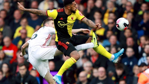 <p>               Sheffield United's Chris Basham, left, and Watford's Andre Gray battle for the ball during the English Premier League soccer match at Vicarage Road, Watford, England, Saturday Oct. 5, 2019. (Ian Walton/PA via AP)             </p>