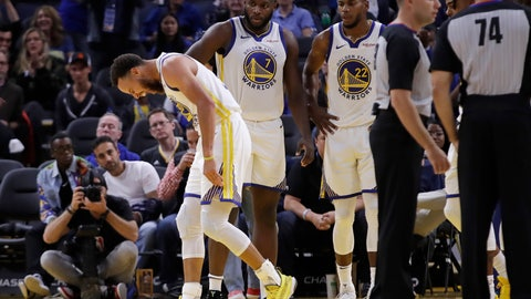 <p>               Golden State Warriors' Stephen Curry, left, grimaces after Phoenix Suns' Aron Baynes fell onto him during the second half of an NBA basketball game Wednesday, Oct. 30, 2019, in San Francisco. Curry left the game. (AP Photo/Ben Margot)             </p>