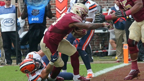 <p>               Florida State's Cam Akers, center, breaks the tackle of Syracuse's Andrew Armstrong to score during the first quarter of an NCAA college football game, Saturday, Oct. 26, 2019, in Tallahassee Fla. (AP Photo/Steve Cannon)             </p>