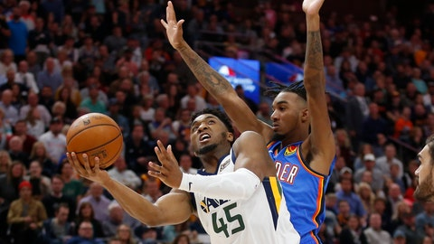 <p>               Oklahoma City Thunder guard Terrance Ferguson, rear, defends against Utah Jazz guard Donovan Mitchell (45) during the second half of an NBA basketball game Wednesday, Oct. 23, 2019, in Salt Lake City. (AP Photo/Rick Bowmer)             </p>