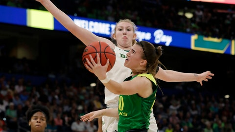 <p>               FILE - In this April 5, 2019, file photo, Oregon guard Sabrina Ionescu (20) drives to the basket as Baylor forward Lauren Cox (15), defends during a Final Four semifinal of the NCAA women's college basketball tournament in Tampa, Fla. Ionescu was named to The Associated Press Preseason All-America women's college basketball team, Thursday, Oct. 31, 2019. (AP Photo/Chris O'Meara, File)             </p>