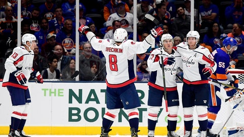 <p>               Washington Capitals right wing T.J. Oshie (77) is congratulated by teammates, including left wing Alex Ovechkin (8), center Nicklas Backstrom (19) and left wing Jakub Vrana (13), after scoring a goal against the New York Islanders during the second period of an NHL hockey game, Friday, Oct. 4, 2019, in Uniondale, N.Y. (AP Photo/Steven Ryan)             </p>