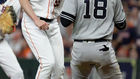 <p>               Houston Astros relief pitcher Ryan Pressly, left, tags out New York Yankees' Didi Gregorius during the third inning in Game 6 of baseball's American League Championship Series Saturday, Oct. 19, 2019, in Houston. (AP Photo/Eric Gay)             </p>