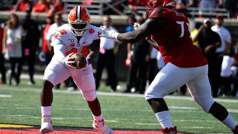 <p>               Clemson defensive tackle Nyles Pinckney (44) makes an interception away from the defense of Louisville offensive lineman Mekhi Becton (73) during the first half of an NCAA college football game in Louisville, Ky., Saturday, Oct. 19, 2019. (AP Photo/Timothy D. Easley)             </p>