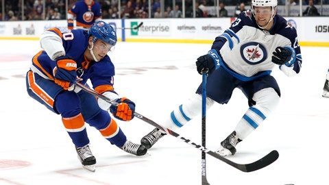<p>               New York Islanders center Derick Brassard (10) and Winnipeg Jets defenseman Carl Dahlstrom (23) reach for the puck during the second period of an NHL hockey game Sunday, Oct. 6, 2019, in Uniondale, N.Y. (AP Photo/Michael Owens)             </p>