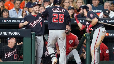 <p>               Washington Nationals' Kurt Suzuki is congratulated after hitting a home run during the seventh inning of Game 2 of the baseball World Series against the Houston Astros Wednesday, Oct. 23, 2019, in Houston. (AP Photo/David J. Phillip)             </p>