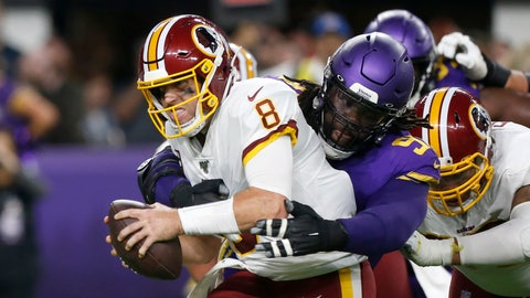 <p>               Washington Redskins quarterback Case Keenum (8) is sacked by Minnesota Vikings defensive tackle Linval Joseph during the first half of an NFL football game, Thursday, Oct. 24, 2019, in Minneapolis. (AP Photo/Jim Mone)             </p>