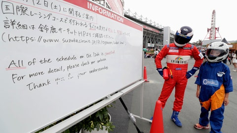 <p>               The circuit information board shows the cancelation for the Oct. 12 schedule at the Japanese Formula One Grand Prix at Suzuka Circuit in Suzuka, central Japan, Friday, Oct. 11, 2019. A powerful typhoon was forecast to bring 2 feet of rain and damaging winds to the Tokyo area this weekend, and Japan's government warned people Friday to stockpile supplies and evacuate before it's too dangerous. (Kyodo News via AP)             </p>