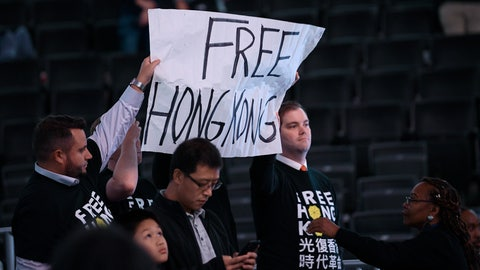 <p>               Activists hold up a sign before an NBA exhibition basketball game between the Washington Wizards and the Guangzhou Loong-Lions, Wednesday, Oct. 9, 2019, in Washington. (AP Photo/Nick Wass)             </p>