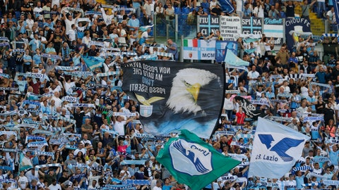 <p>               Lazio fans cheer during a Serie A soccer match between Lazio and Genoa, at the Rome Olympic Stadium, Sunday, Sept. 29, 2019. (AP Photo/Andrew Medichini)             </p>