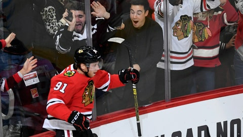 <p>               Chicago Blackhawks' Drake Caggiula (91) celebrates after scoring a goal during the first period of an NHL hockey game against the Columbus Blue Jackets, Friday, Oct 18, 2019, in Chicago. (AP Photo/Paul Beaty)             </p>