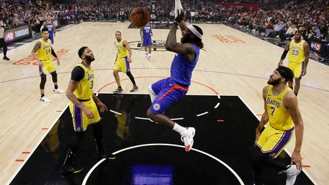 <p>               Los Angeles Clippers' Montrezl Harrell, center, dunks against the Los Angeles Lakers during the first half of an NBA basketball game Tuesday, Oct. 22, 2019, in Los Angeles. (AP Photo/Marcio Jose Sanchez)             </p>