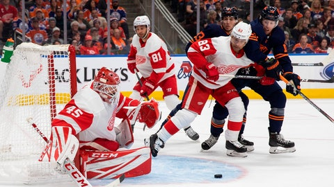 <p>               Detroit Red Wings goaltender Jonathan Bernier (45) watches the puck as teammate Trevor Daley (83) defends against Edmonton Oilers center Ryan Nugent-Hopkins (93) and left wing James Neal (18) during the second period of an NHL hockey game Friday, Oct. 18, 2019, in Edmonton, Alberta. (Codie McLachlan/The Canadian Press via AP)             </p>