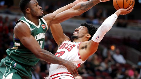 <p>               Milwaukee Bucks' Thanasis Antetokounmpo, left, pressures Chicago Bulls' Otto Porter Jr. during the first half of an NBA preseason basketball game Monday, Oct. 7, 2019, in Chicago. (AP Photo/Charles Rex Arbogast)             </p>