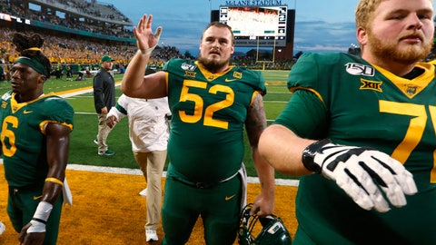 <p>               In this Saturday, Oct. 12, 2019, photo, Baylor offensive lineman Sam Tecklenburg, center, thanks the fans after the team's win over Texas Tech in an NCAA college football game in Waco, Texas. Standing next to Techlenburg are JaMycal Hasty, left, and Jim Threet, Tecklenburg is among 10 current seniors who redshirted in 2015, when Baylor was coming off back-to-back Big 12 titles and had its last eight-game winning streak. There is also sixth-year receiver Chris Platt, who was playing as a redshirt that season and got an extra year of eligibility after a season-ending knee injury four games in the 2017 season. They all stayed in the aftermath of a sprawling sexual assault scandal that led to coach Art Briles getting fired before the 2016 season. (Rod Aydelotte/Waco Tribune-Herald via AP)             </p>