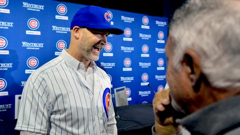 <p>               Chicago Cubs' new manager David Ross, left, talks with reporters after a press conference where he was introduced on Monday, Oct. 28, 2019, in Chicago. (AP Photo/Matt Marton)             </p>