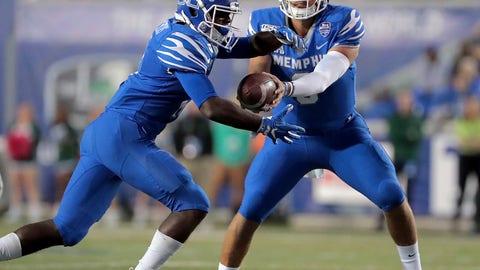 <p>               Memphis quarterback Brady White, right, shuffles the ball to running back Kylan Watkins during an NCAA college football game against Tulane on Saturday, Oct. 19, 2019, in Memphis, Tenn. (Jim Weber/Daily Memphian via AP)             </p>