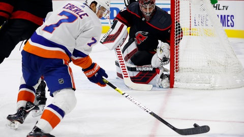 <p>               Carolina Hurricanes goaltender Petr Mrazek (34), of the Czech Republic, watches the puck controlled by New York Islanders' Jordan Eberle (7) during the third period of an NHL hockey game in Raleigh, N.C., Friday, Oct. 11, 2019. (AP Photo/Karl B DeBlaker)             </p>