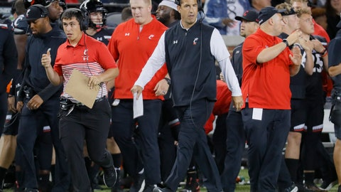<p>               Cincinnati coach Luke Fickell walks along the sideline during the first half of the team's NCAA college football game against UCF, Friday, Oct. 4, 2019, in Cincinnati. (AP Photo/John Minchillo)             </p>