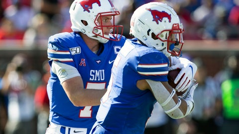 <p>               SMU quarterback Shane Buechele (7) hands the ball off to running back Xavier Jones (5) during the second quarter of an NCAA college football game against Temple in Dallas, Saturday, Oct. 19, 2019. (AP Photo/Sam Hodde)             </p>