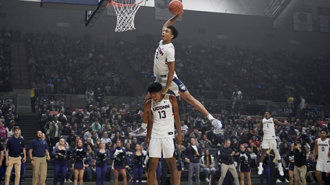 <p>               Connecticut's James Bouknight, top, leaps over teammate Richard Springs to dunk the ball during UConn's men's and women's basketball teams' annual First Night celebration in Storrs, Conn. (AP Photo/Jessica Hill)             </p>