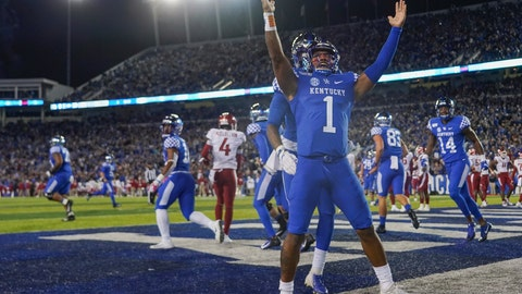 <p>               Kentucky quarterback Lynn Bowden Jr. (1) celebrates after scoring a touchdown during the first half of the team's NCAA college football game against Arkansas, Saturday, Oct. 12, 2019, in Lexington, Ky. (AP Photo/Bryan Woolston)             </p>