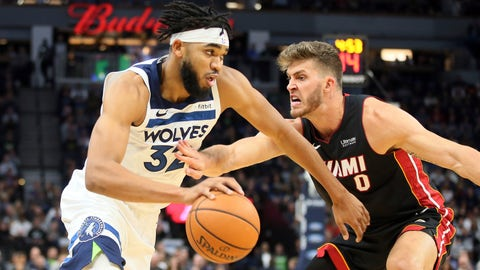 <p>               Minnesota Timberwolves' Karl-Anthony Towns, left, drives against Miami Heat's Meyers Leonard in the first half of an NBA basketball game Sunday, Oct. 27, 2019, in Minneapolis. (AP Photo/Jim Mone)             </p>