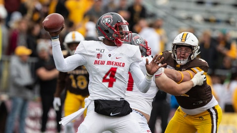 <p>               FILE - In this Oct. 19, 2019 file photo, New Mexico quarterback Sheriron Jones (4) throws a pass against Wyoming during an NCAA college football game in Laramie, Wy. New Mexico has suspended Jones indefinitely from the team for undisclosed reasons. (AP Photo/Michael Smith, File)             </p>