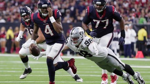 <p>               Houston Texans quarterback Deshaun Watson (4) holds his eye as he is pressured by Oakland Raiders defensive end Maxx Crosby (98) as he looks pass during the second half of an NFL football game Sunday, Oct. 27, 2019, in Houston. Watson completed the pass to tight end Darren Fells for a touchdown. (AP Photo/Michael Wyke)             </p>