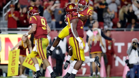 <p>               Southern California running back Kenan Christon (23) celebrates his rushing touchdown with offensive tackle Jalen McKenzie during the second half of an NCAA college football game against Arizona Saturday, Oct. 19, 2019, in Los Angeles. (AP Photo/Marcio Jose Sanchez)             </p>