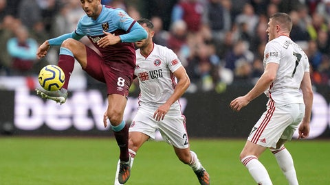 <p>               West Ham United's Felipe Anderson, left, in action with Sheffield United's George Baldock, centre and John Lundstram during the English Premier League soccer match between West Ham United and Sheffield United at the London Stadium, London, Saturday, Oct. 26 2019. (John Walton/PA via AP)             </p>