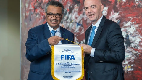 "<p>               FIFA President Gianni Infantino, right, and Tedros Adhanom Ghebreyesus, left, Director General of the World Health Organization (WHO), pose for the media at the World Health Organization (WHO) headquarters in Geneva, Switzerland, Friday, Oct. 4, 2019. FIFA president Gianni Infantino says a new partnership with the U.N. health agency is a ""starting point"" to help leverage the global appeal of soccer to improve health outcomes. Infantino says the association with the World Health Organization will work to ""elaborate concrete solutions"" and insists that FIFA's corporate sponsors, including Coca-Cola and McDonald's, are ""progressing"" on health. (Martial Trezzini/Keystone via AP)             </p>"