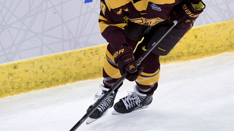 """<p>               FILE - In this Sunday, March 24, 2019 file photo, Minnesota's Taylor Heise (9) controls the puck during the third period in the NCAA Division I women's Frozen Four hockey championship game against Wisconsin in Hamden, Conn. A viable professional hockey league for women is the goal of the current crop of veteran players, and the youngsters who dream of playing the sport professionally when they get older are behind the current efforts being made. Sophomore Taylor Heise of the University of Minnesota, says having them fight for players like her """"is amazing."""" (AP Photo/Stephen Dunn, File)             </p>"""