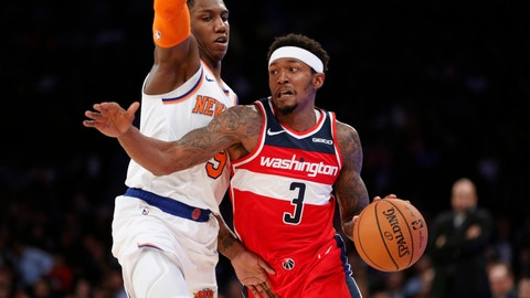 <p>               Washington Wizards guard Bradley Beal (3) drives around New York Knicks forward RJ Barrett during the first half of a preseason NBA basketball game in New York, Friday, Oct. 11, 2019. (AP Photo/Kathy Willens)             </p>