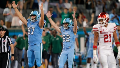 <p>               Tulane's Merek Glover (62) celebrates a go-ahead field goal with holder Ryan Wright (97) in front of Houston' Gleson Sprewell (21) during the second half of an NCAA college football game in New Orleans, Thursday, Sept. 19, 2019. Tulane won 38-31. (AP Photo/Gerald Herbert)             </p>
