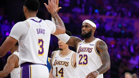 <p>               Los Angeles Lakers forward LeBron James congratulates forward Anthony Davis during a timeout in the first half of the team's preseason NBA basketball game against the Golden State Warriors on Wednesday, Oct. 16, 2019, in Los Angeles. (AP Photo/Mark J. Terrill)             </p>